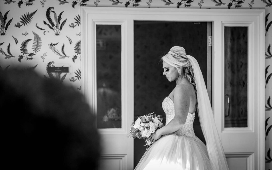 Bride photographed in the hallway at Wentbridge House Hotel
