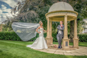 fun photograph of the bride and groom with brides flowing veil at Wentbridge House