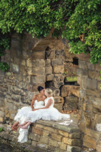 Two brides kiss at Waterton Park in Wakefield