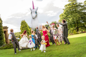 Unicorn chasing the wedding party at Waterton Park in Wakefield