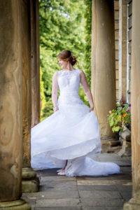 Bride swinging her on the steps at Waterton Park in Wakefield