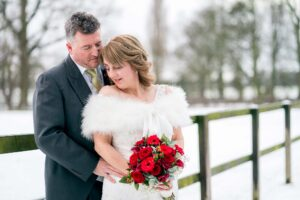 Bride and Groom photographed in winter at the Bridge Inn Wetherby