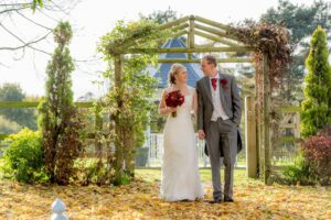Bride and groom in autumn at The Bridge Inn Wetherby