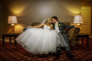 Bride and groom sitting down photography at The Bridge Inn, Walshford, Wetherby near Leeds