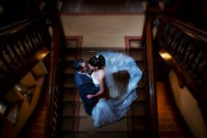 Bride and groom on the stairs at Carlton Towers on their wedding