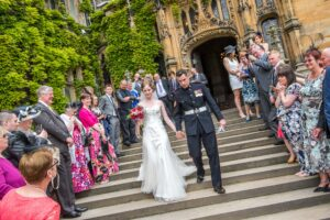 Bride and groom with confetti at Carlton Towers