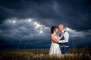Evening shot in wheat field with bride and groom at Kins Croft Hotel in Pontefract