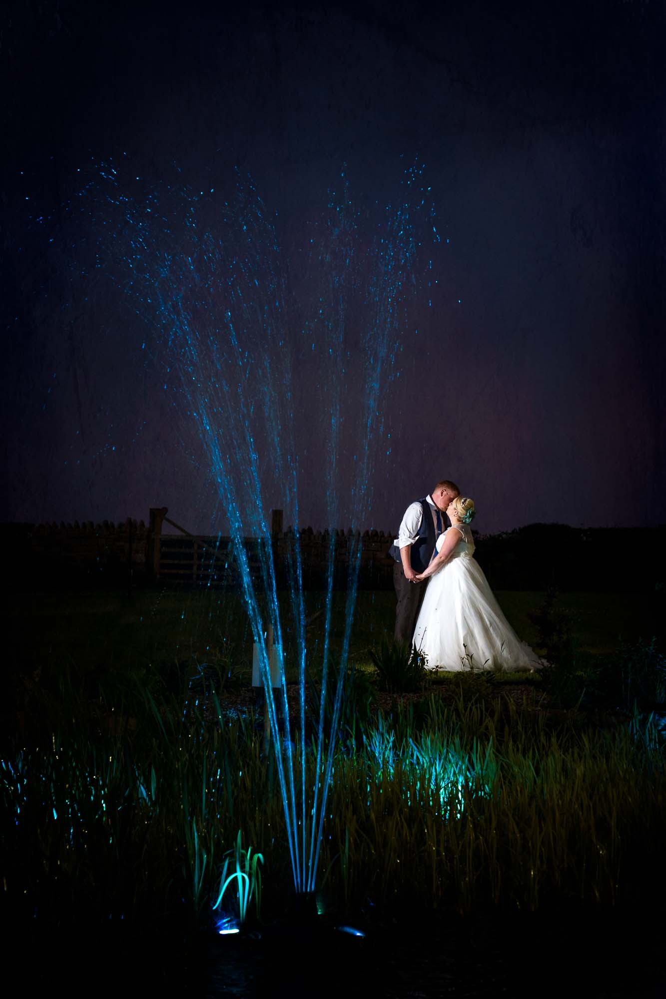 Twilight fountain shot with bride and groom in Pontefract