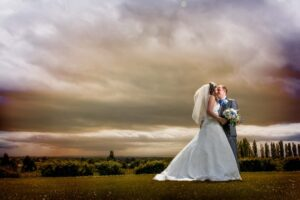 Moody sky shot with bride and groom at Kings Croft Hotel in Pontefract
