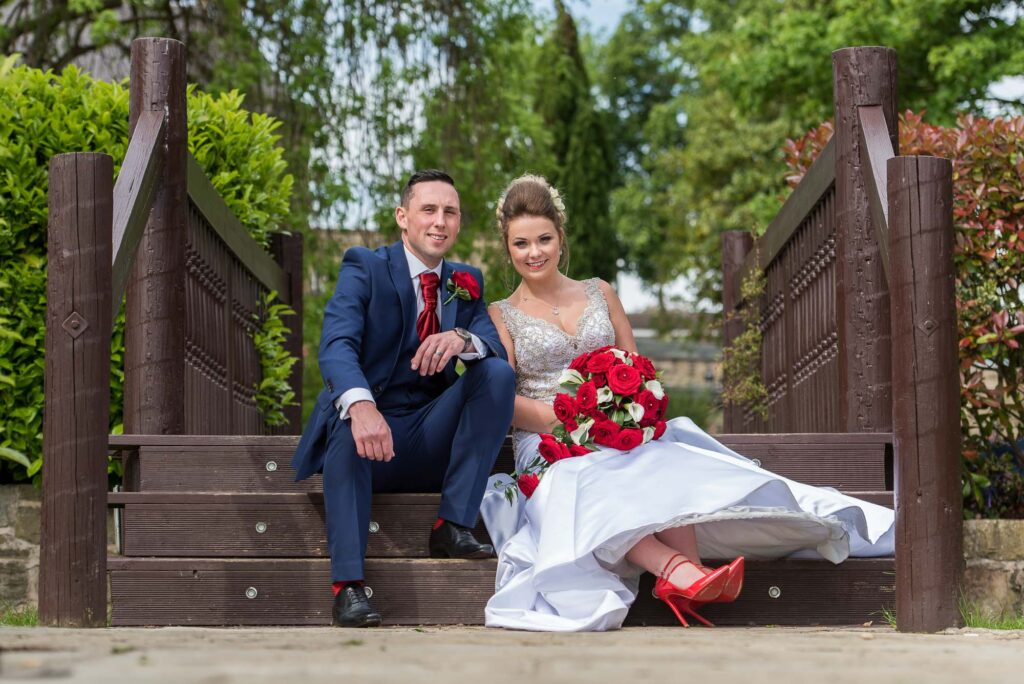 Bride with bright red shoes at Kings Croft Hotel In Pontefract