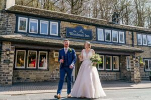 Bride and groom walking down the street in Huddesfield