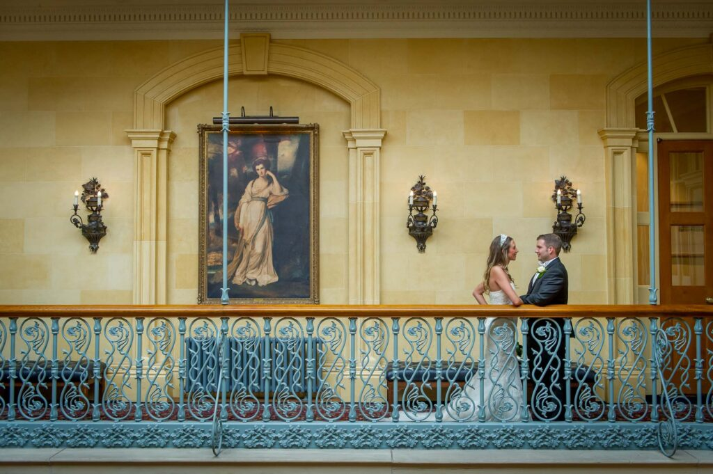 Bride and groom on the balcony at Oulton Hall in Leeds