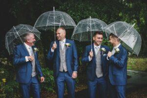 Groomsmen talking in the rain in Mirfield