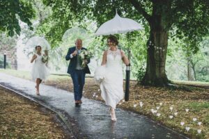 Bride no the way to the ceremony in the rain in Mirfield