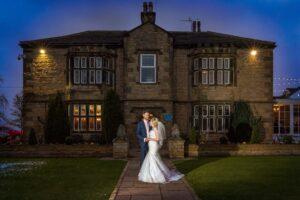 bride and groom twilight shot at Rogerthorpe Manor Hotel