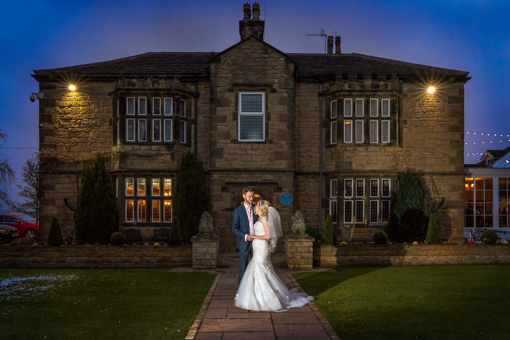bride and groom twilight shot at Rogerthorpe Manor Hotel