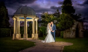Evening shot of the folly with the bride and groom at Rogerthorpe Manor in Pontefract