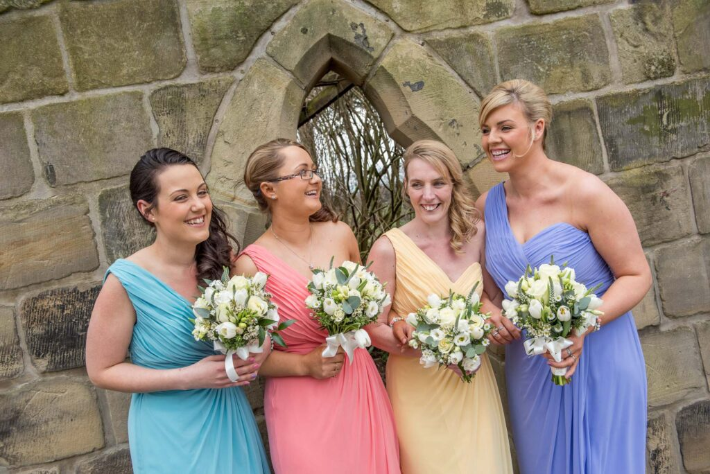 colourful bridesmaids at Rogerthorpe Manor in Pontefract