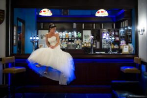 Bride on the bar at Rogerthorpe Manor Hotel in Pontefract