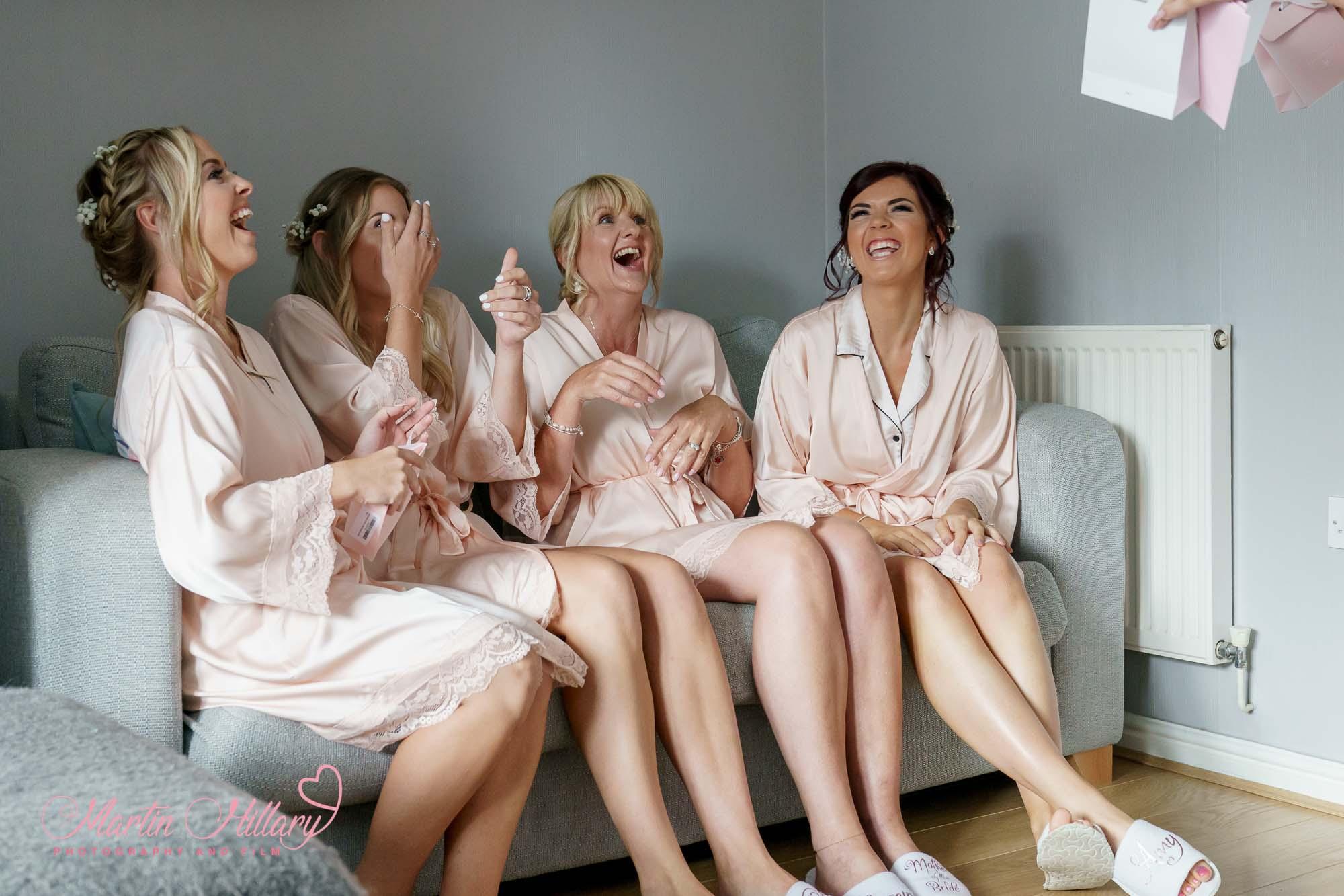Bridesmaids laughing during bridal preps