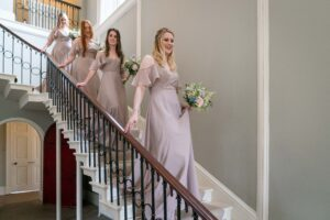 Bridemaids on the stairs at Saltmarshe Hall