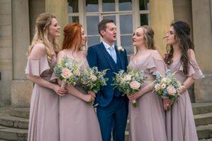groom with bridesmaids at Saltmarshe Hall