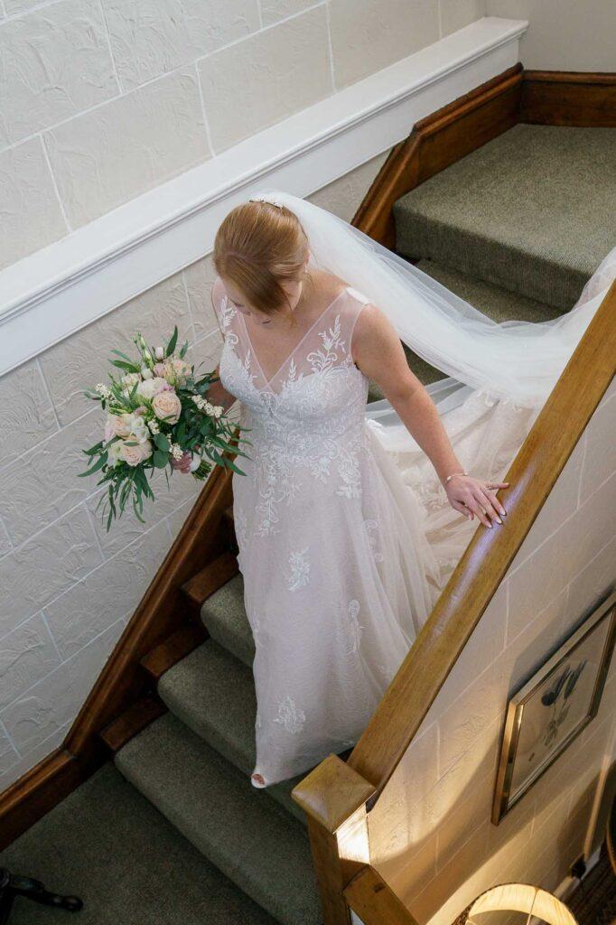 Bride on stairs at Wentbridge House Hotel in Pontefract