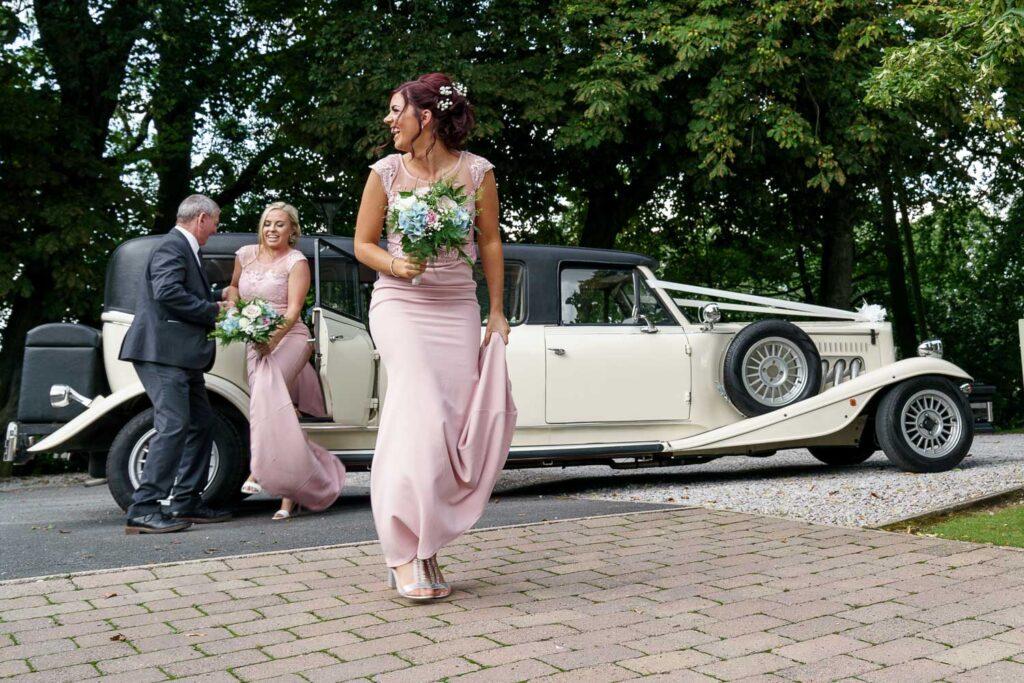 Bridesmaids leaving car at Woodlands Hotel in Leeds