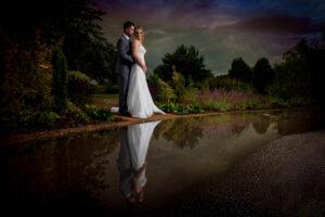 Bride and groom reflection shot at Sandburn Hall Hotel