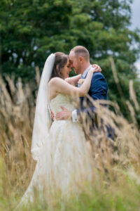 Bride and groom in long grass at Wentbridge House Hotel