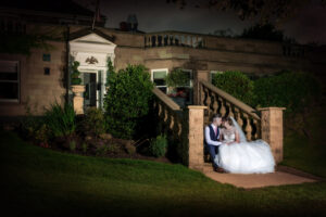 Bride and groom sat on step at Wentbridge House Hotel