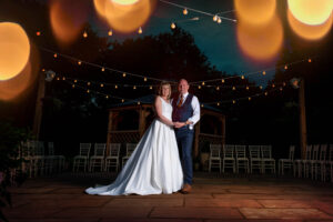 Bride and groom outside in twilight at Whitley Hall Hotel