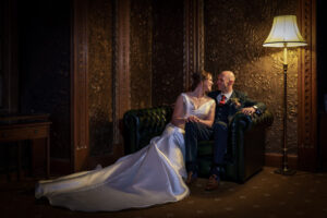 Bride and groom wedding photography in the Gold Room at Hazlewood Castle