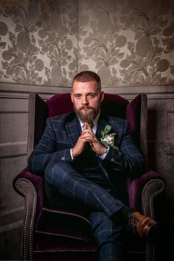 Groom posed in the Drawing Room at Wentbridge House Hotel