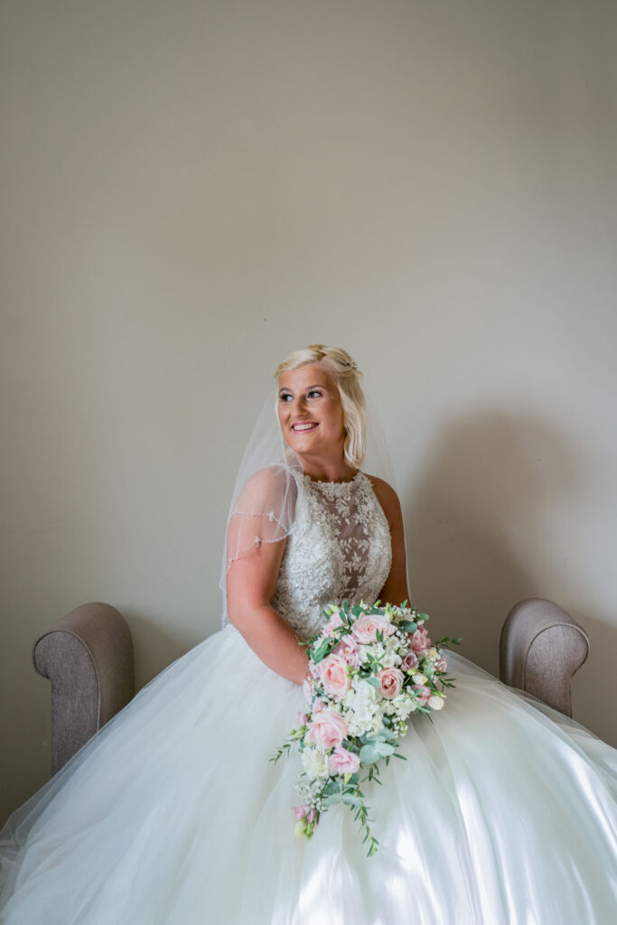 Bride looking out of the window at Wentbridge House Hotel