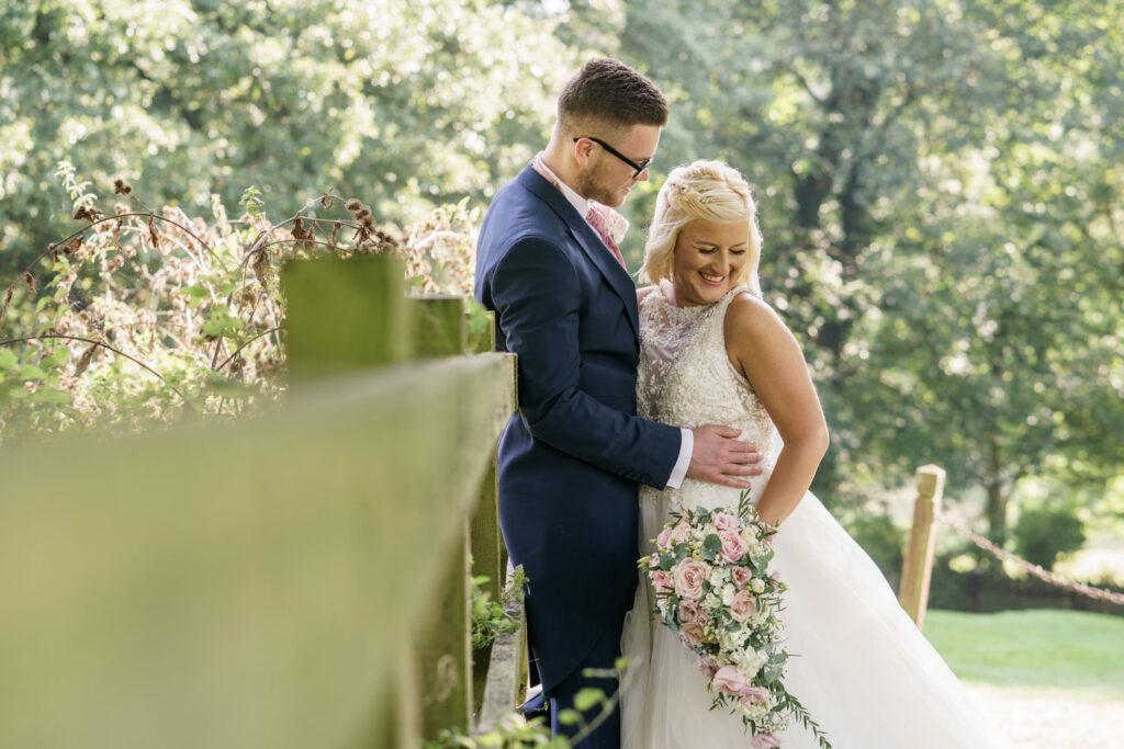 Bride and groom in autumn sun at Wentbridge House Hotel