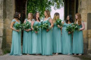 Bridesmaids talking outside church